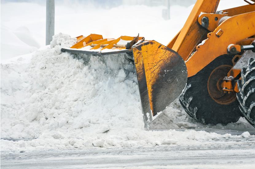 Loader pushing snow